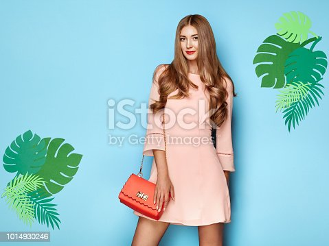 1078252326 istock photo Blonde young woman in floral spring summer dress 1014930246