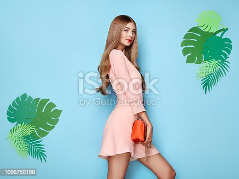 1078252326 istock photo Blonde young woman in floral spring summer dress 1056750156