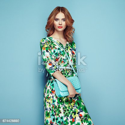 istock Blonde young woman in floral spring summer dress 674426692