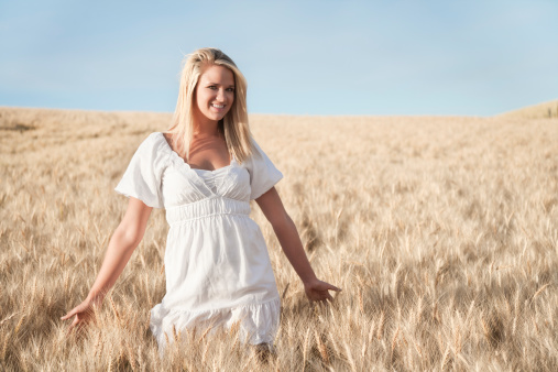Blonde Young Woman In Golden Wheat Field Stock Photo - Download Image Now