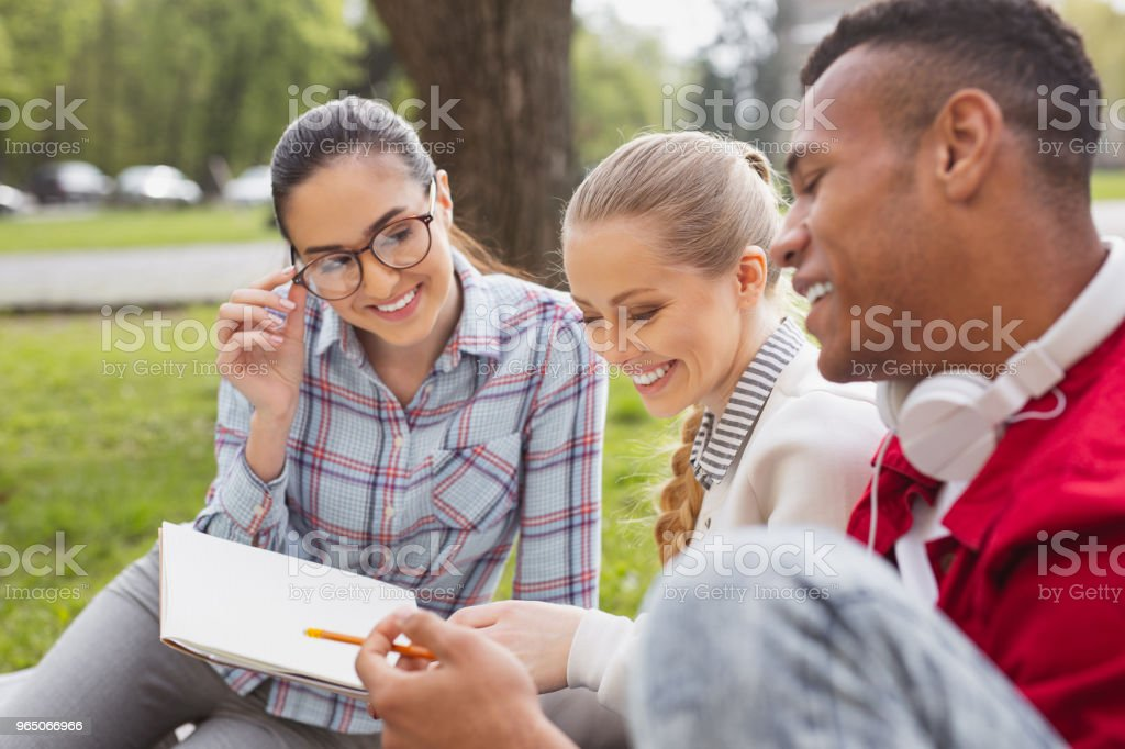 Blonde-haired student smiling broadly after passing exam royalty-free stock photo