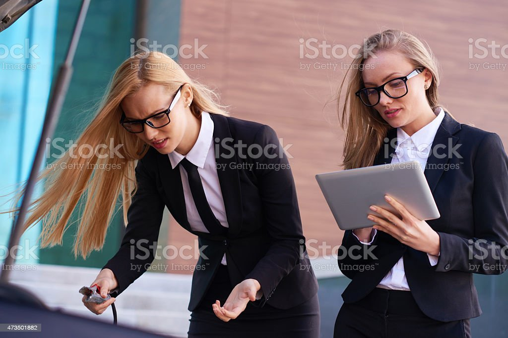 Blondes tackling the problem stock photo