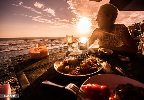 istock Blondie woman eating lunch in beach restaurant. 904558816