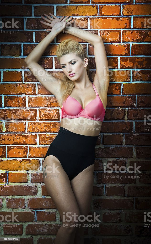 Blone girl in swimsuit posing provocatively stock photo