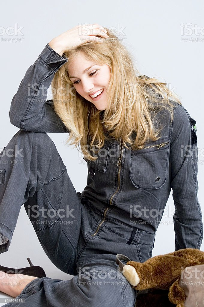 Blong Girl Sitting And Laughing stock photo
