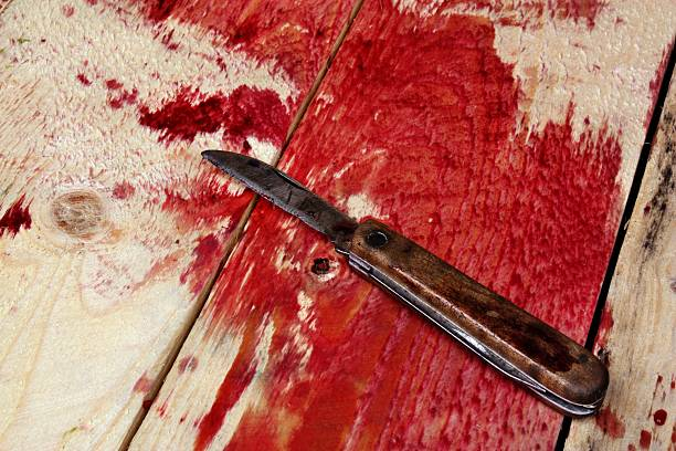 Blood and knife stock photo