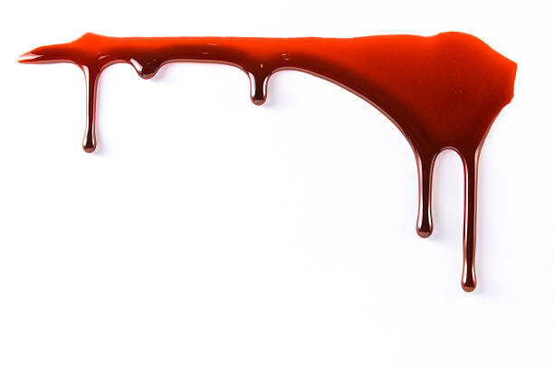 Blood dropping stock photo
