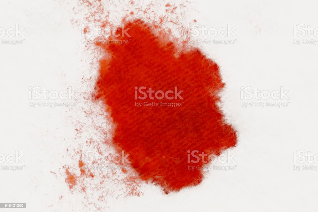 Blood drops on the cotton pad, close up view stock photo