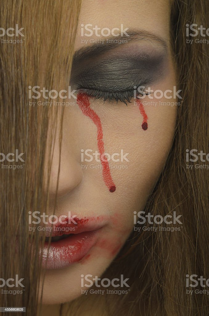 Blood from the eyes and face of woman royalty-free stock photo