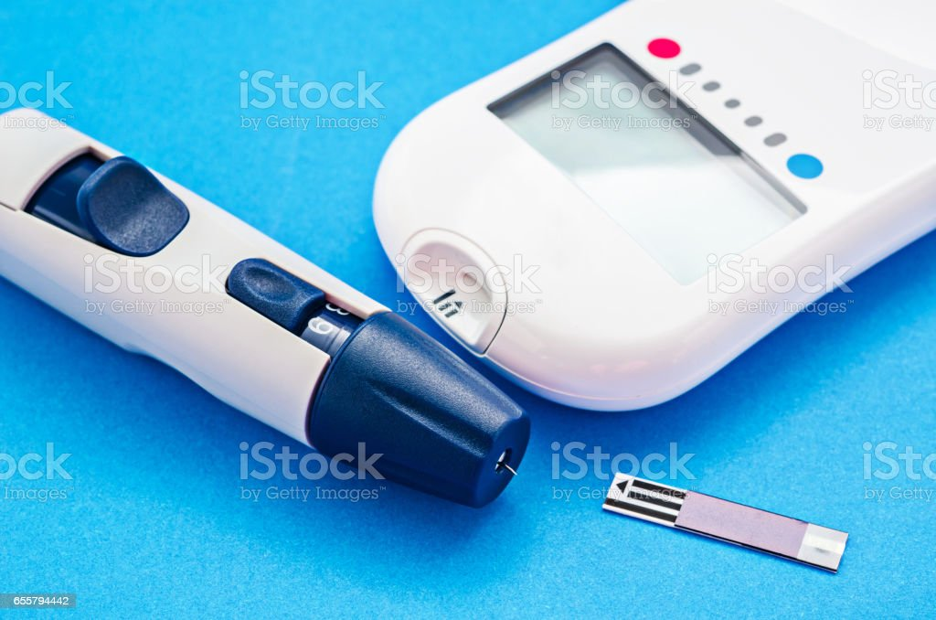 blood glucose meter stock photo