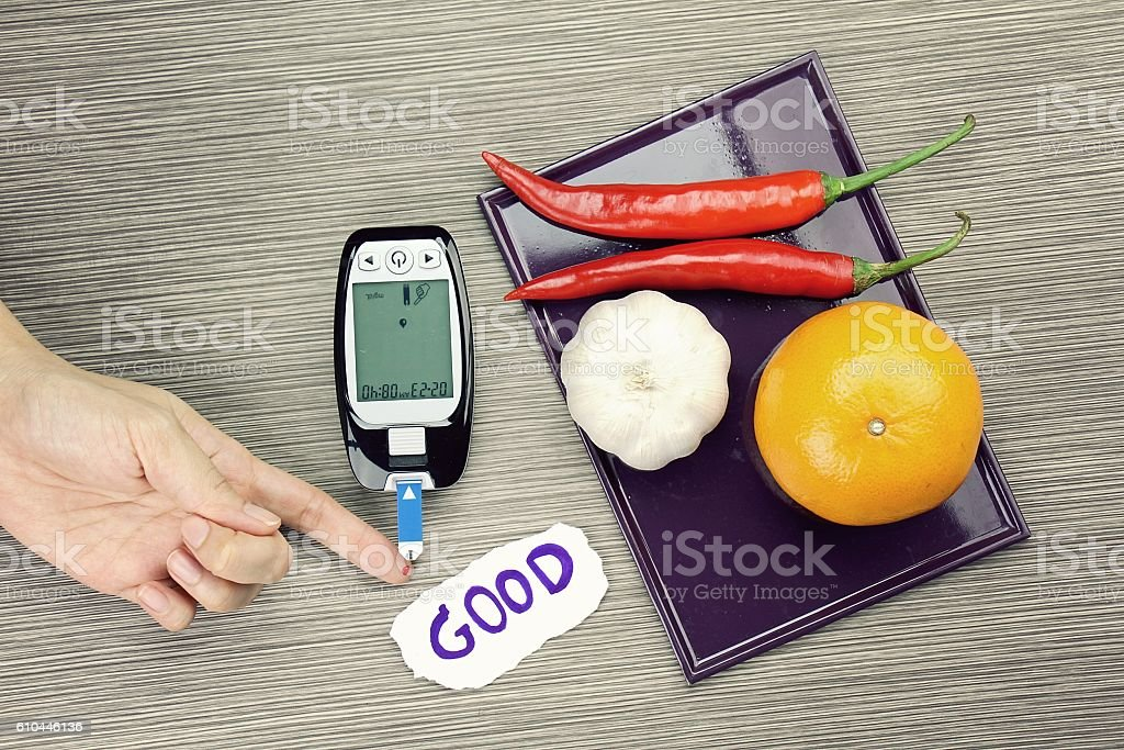 Blood glucose meter test and herbs. Healthy food eating concept stock photo