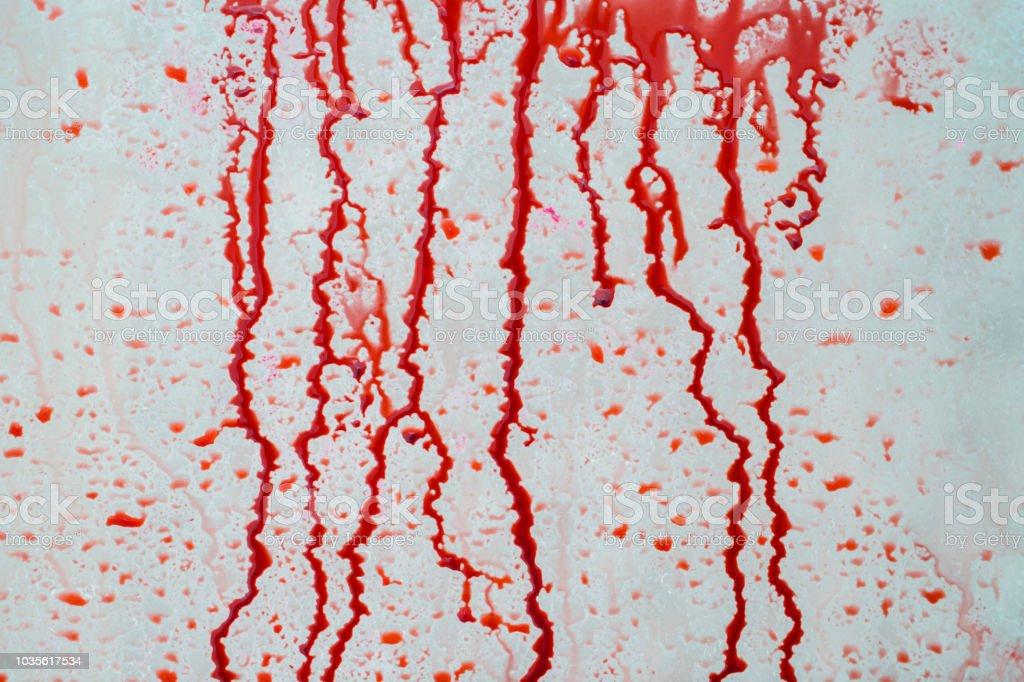 Blood liquid splattered on the wall stock photo