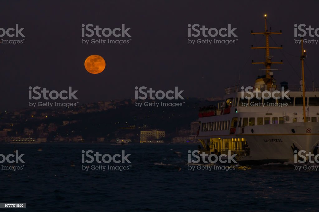 Blood moon and vessel stock photo