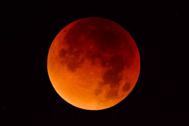 Blood moon - full Lunar Eclipse in the night sky stock photo