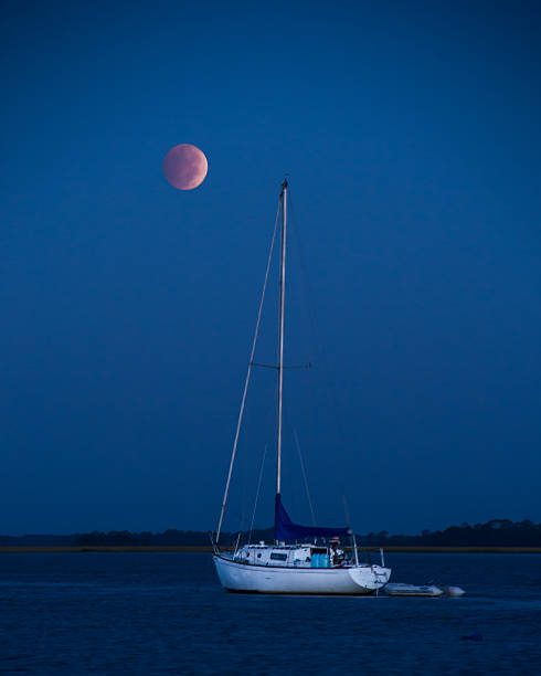 Blood Moon with boat stock photo
