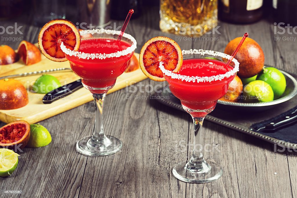 Blood Orange Margaritas with Ingredients on Bar stock photo