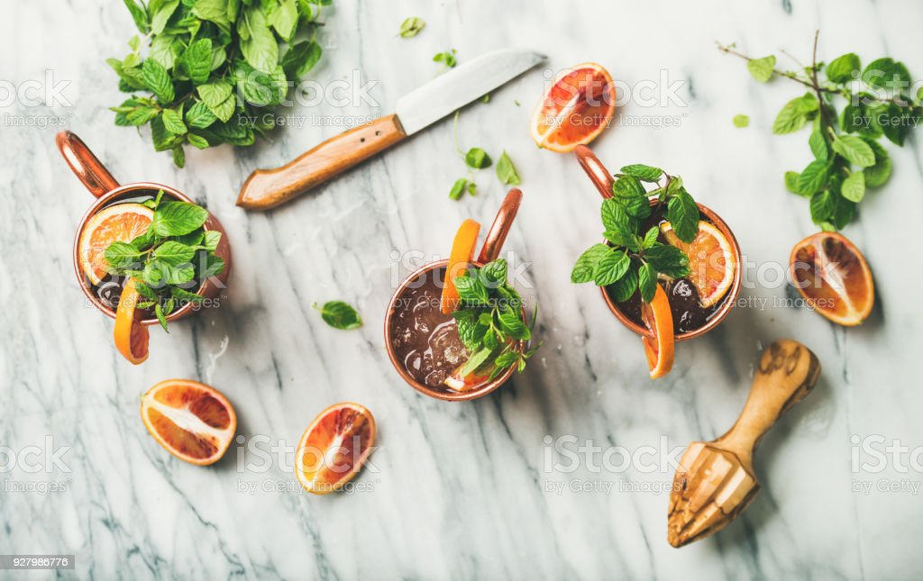 Blood orange Moscow mule alcohol cocktails, marble background stock photo