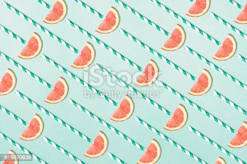istock Blood orange pattern on aquamarine background 919570638