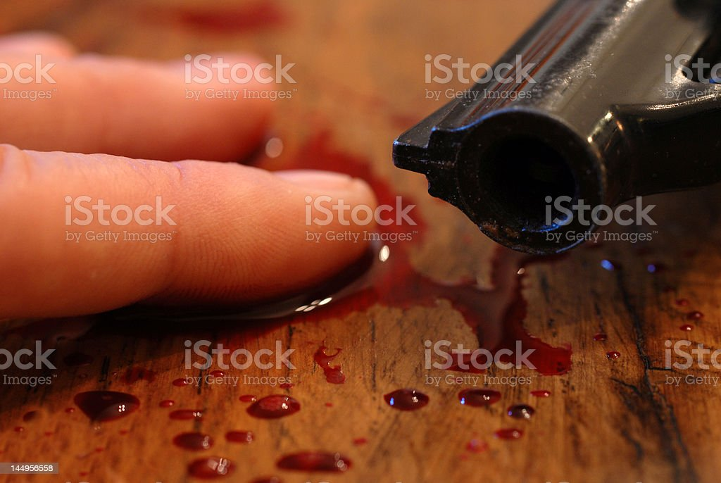 blood, pistol and death stock photo