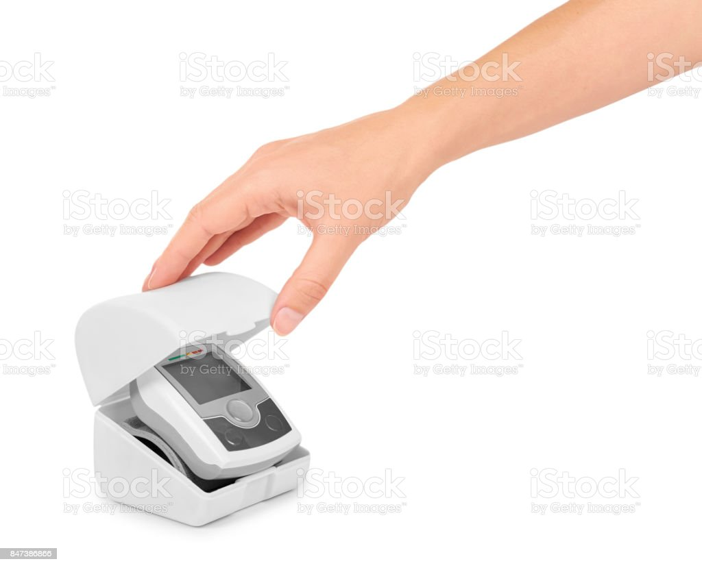 blood pressure measurement equipment tensiometer in hand isolated on white background stock photo