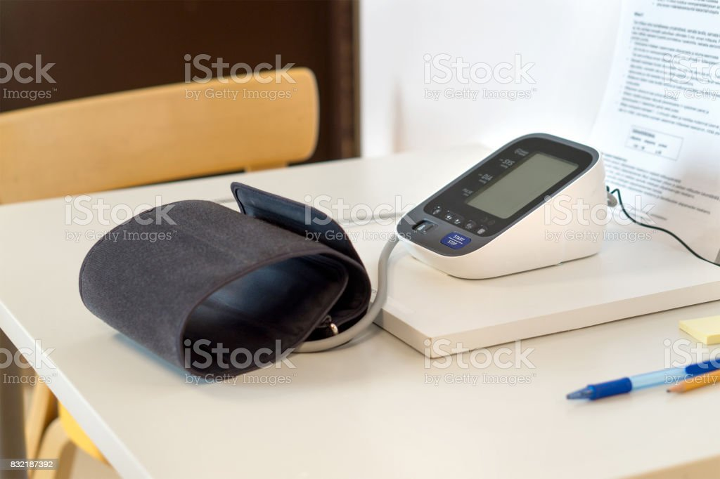 Blood pressure meter on table in hospital or health care center. stock photo