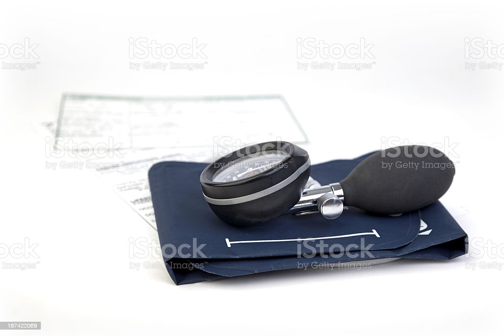 Blood pressure sphygmomanometer with record cards royalty-free stock photo