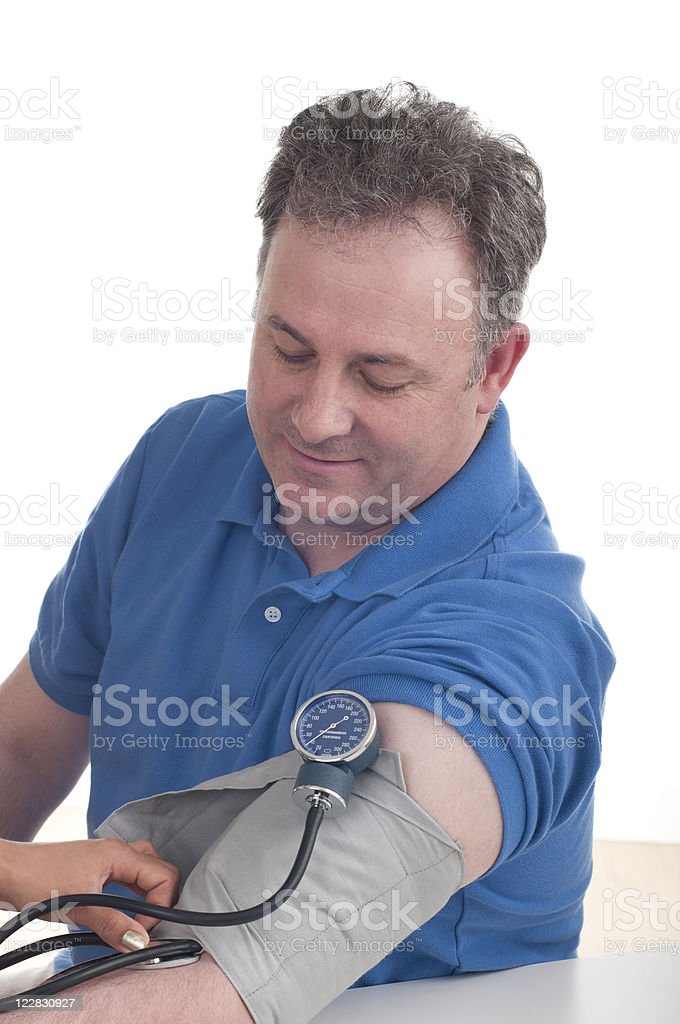 Blood Pressure Test On Smiling Mature Caucasian Man royalty-free stock photo
