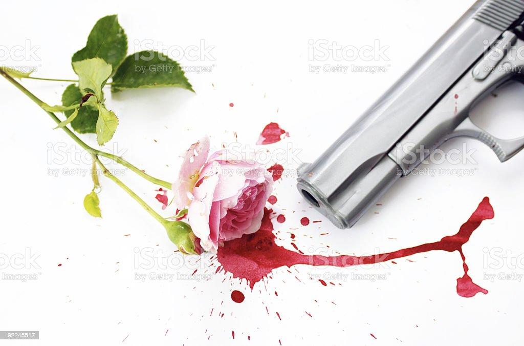 Blood Rose and Gun stock photo