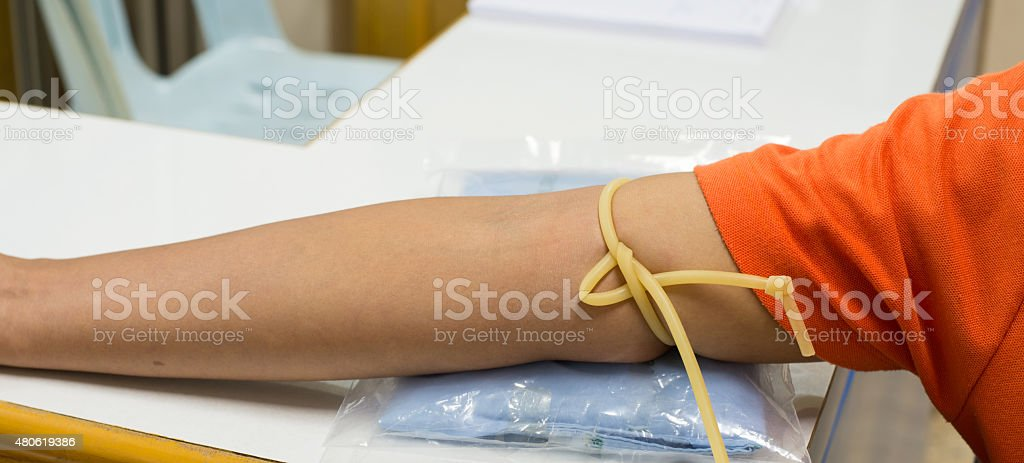 Blood sampling with syringe and needle for analysis stock photo