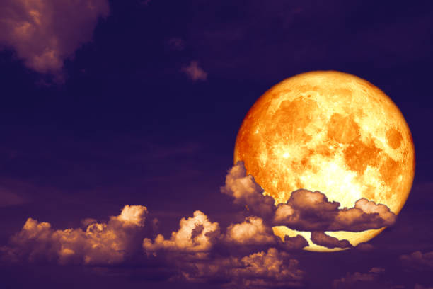 blood strawberry moon back on silhouette heap cloud on sunset sky stock photo