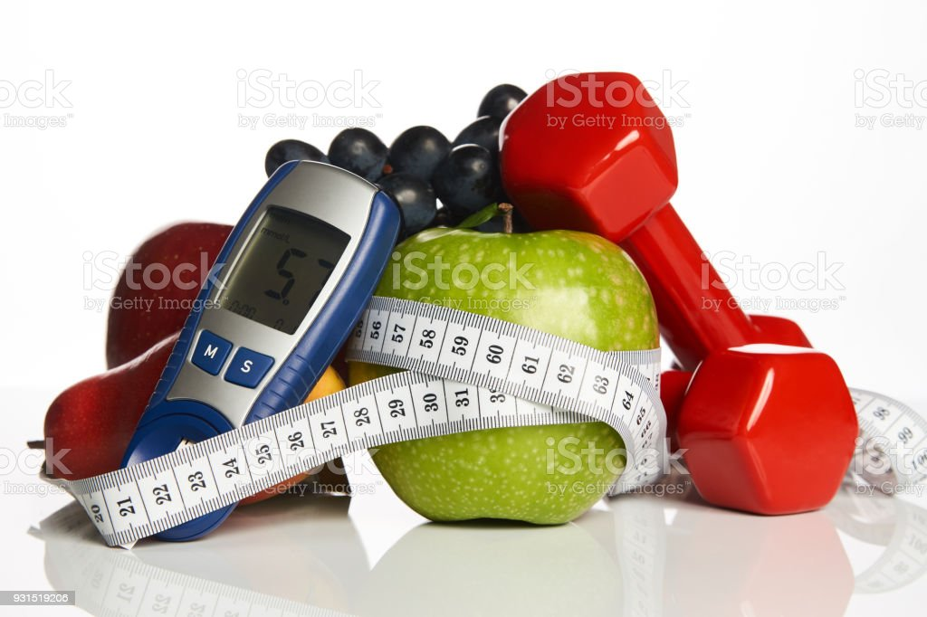 Blood sugar control with healthy organic food and dumbbells with stock photo