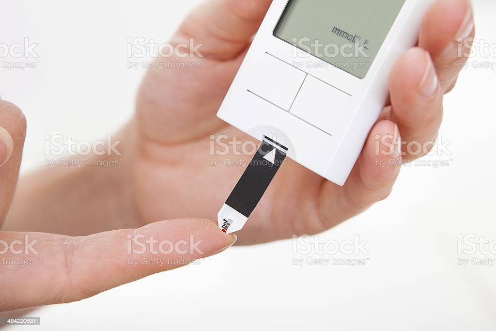 Blood sugar level testing machine stock photo