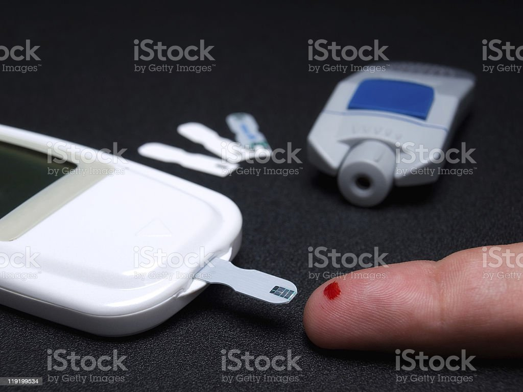 Blood sugar testing royalty-free stock photo
