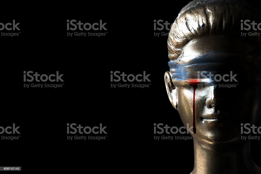 Blood tear of Themis (Concept of injustice) stock photo
