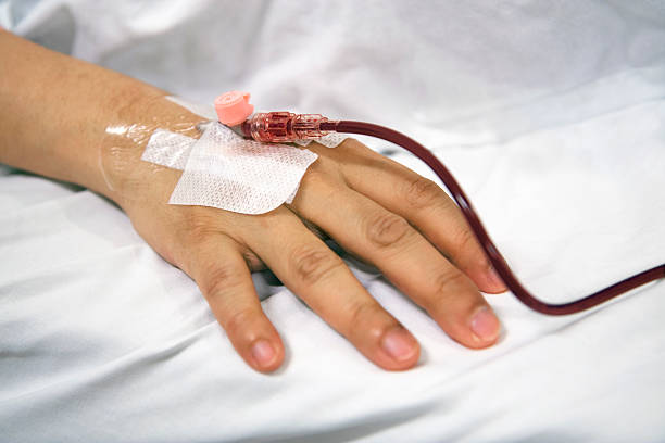 Blood transfusion Patient recieving new blood intravenously. anemia stock pictures, royalty-free photos & images