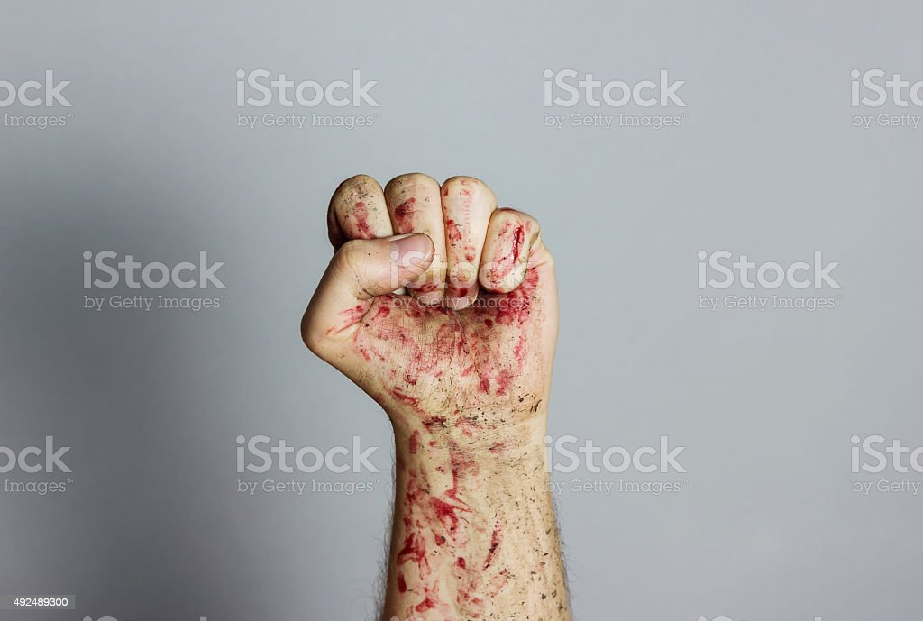 bloody and dirty left fist raising up stock photo