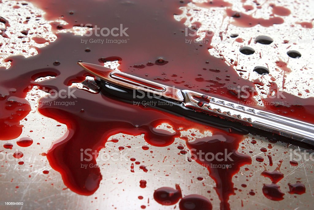 Bloody autopsy table stock photo