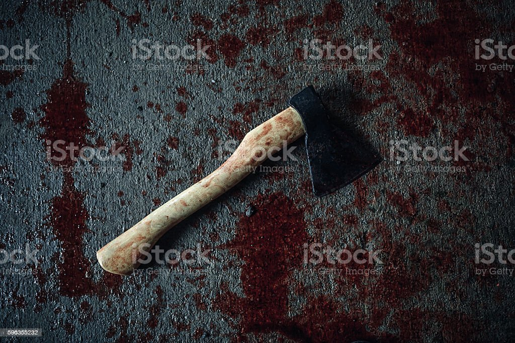 Bloody ax lying on the floor royalty-free stock photo