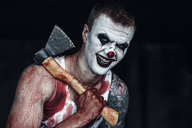 Bloody clown-maniac with ax - foto de stock