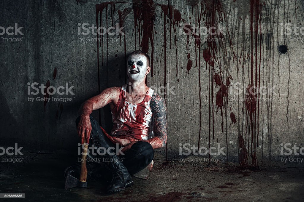 Bloody clown-maniac with ax royalty-free stock photo
