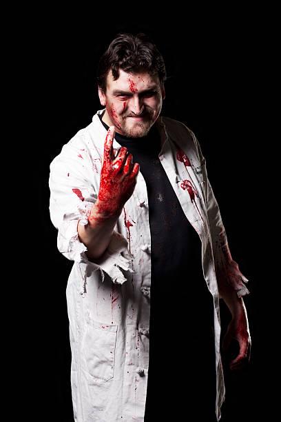 Bloody Doctor Halloween Costume Portrait on Black, Copy Space stock photo