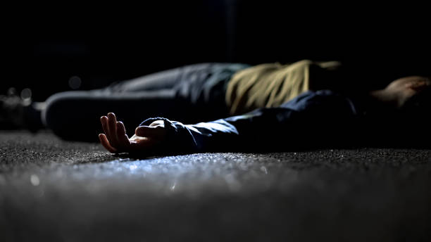 Bloody female victim of deadly car accident lying on road, close-up view at body Bloody female victim of deadly car accident lying on road, close-up view at body dead stock pictures, royalty-free photos & images