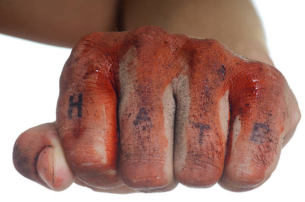 bloody fist with word hate - knuckle stock photos and pictures