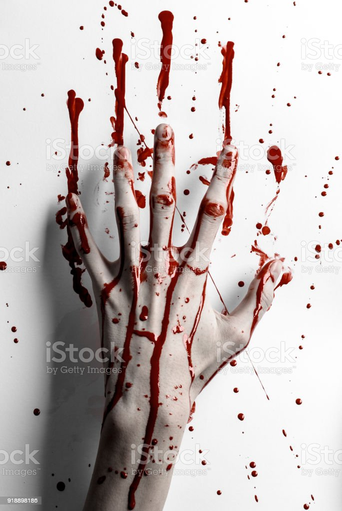 Bloody halloween theme: bloody hand print on a white leaves bloody wall - foto stock