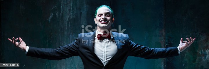 istock Bloody Halloween theme: crazy joker face 599141814