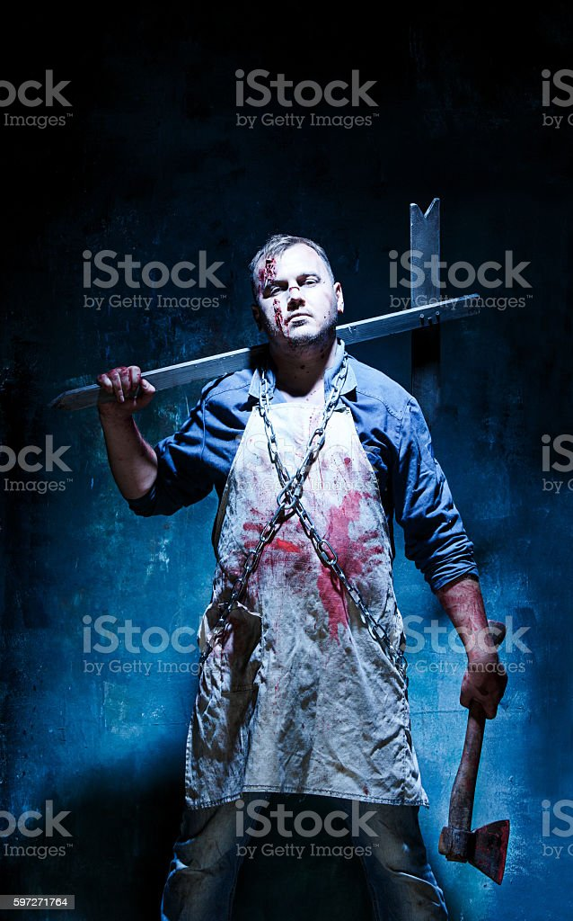 Bloody Halloween theme: crazy killer as butcher with an ax royalty-free stock photo