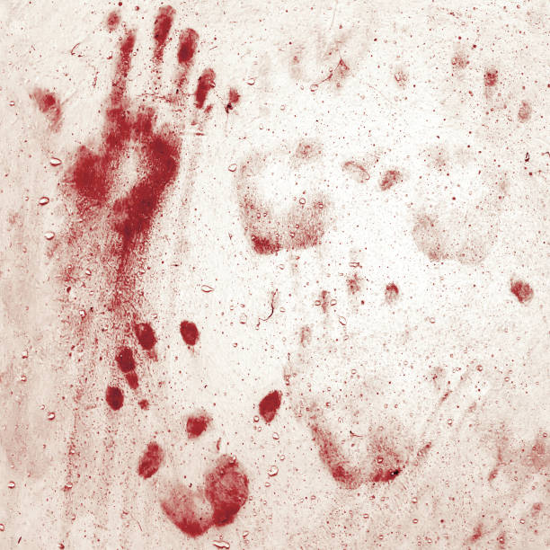 Bloody handprints on wall stock photo