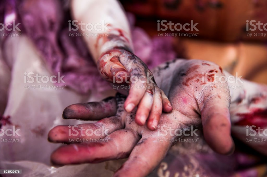 Bloody Hands of Child and Adult stock photo