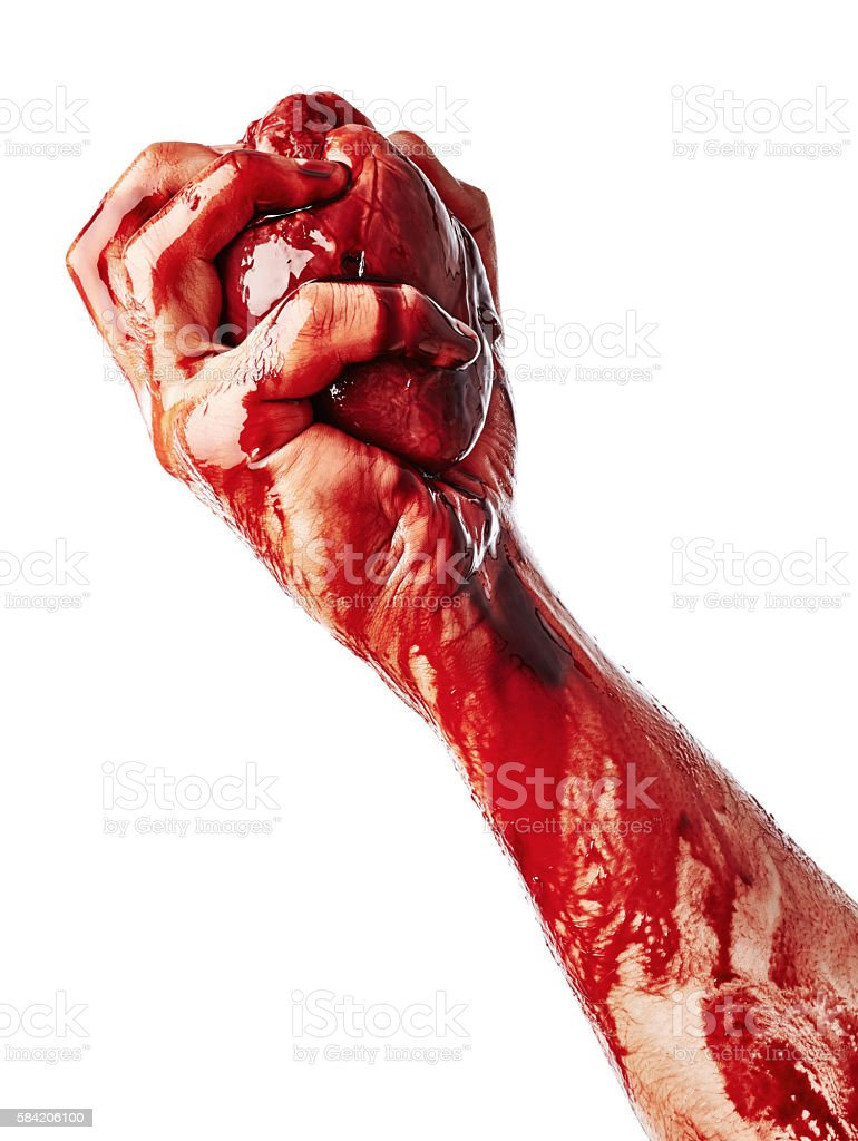 Bloody heart in male hand stock photo