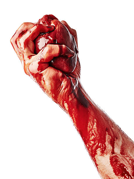 Bloody heart in male hand - foto stock